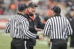 Massillon football coach Jason Hall discusses a call with officials during a 2012 game