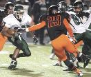 INDEPENDENT KEVIN WHITLOCK Nordonia s Denzel Ward, left, tries to avoid Massillon s Lyron Wilson (29) during last year s playoff game  Ward is one of the Knights  top returnees this season  No Published Caption