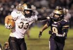 REPOSITORY BOB ROSSITER n St Thomas Frank DiMarzio stiff arms Brookfields Nate Morrison during the first quarter of play