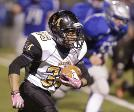 Marlington s Caleb Simmons looks for runnign room in the second quarter at Hubbard Friday