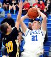 Lake s Alex Belinsky from the baseline against Perry s Conner McHenry