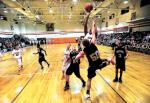 TIMES REPORTER PAT BURK n Claymont s Dylan Sterling flies in for a basket as River View s Andy Parsons tries to block during Friday s throwback game at  The Pit,  Claymont s former home court, in Uhrichsville