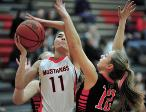 TIMES-REPORTER JIM CUMMINGS n Claymont s Courtney Sowers drives to the basket as Strasburg s Melissa Cregan defends in Monday s game