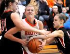 Hoover s Julie Worley fights through tough defense from Lakota West s Lexi Wasan and Ellie Kivell to score during a game at the Classic In the Country Challenge at Berlin Hiland High School