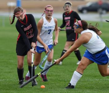 North Carroll s Mia Heindel plays the ball upfield in front of Walkersville s Hannah Chavez and Alli Mori Wednesday, Oct  29 at Walkersville High School